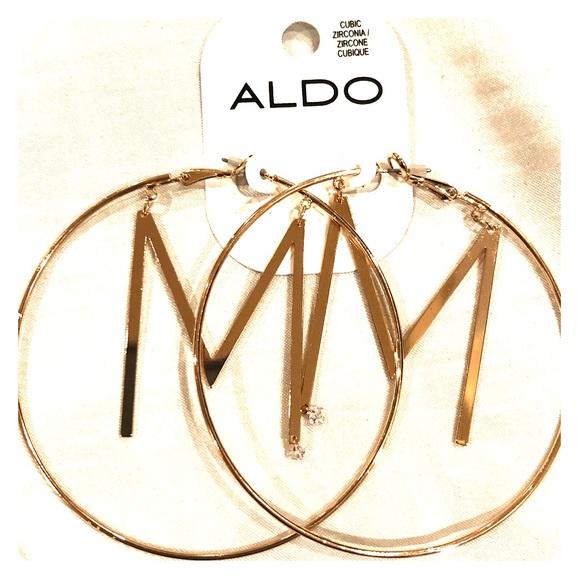 Gold brand new earrings